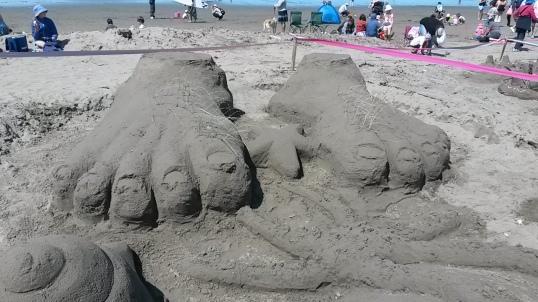 Giant Feet on the Beach