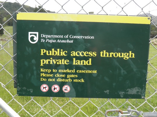 DOC sign at the transition between public and private land