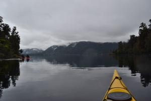 Kayaking across Lake Mapourika (Photo courtesy of Glacier Country Kayaks)