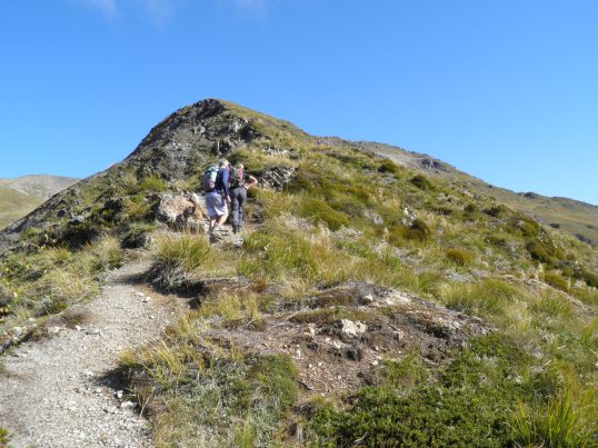 Hikers ahead on the upper slopes of Avalanche Peak