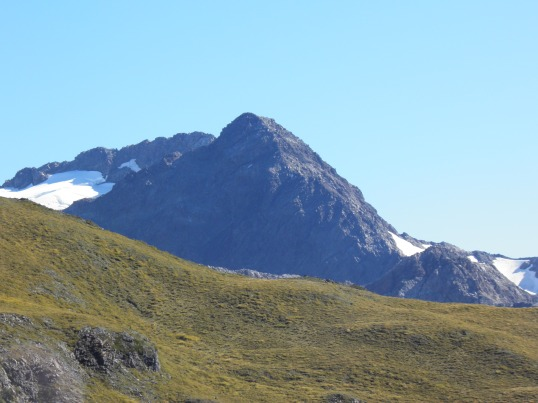 Mt Rolleston peaks up behind the slope of Avalanche Peak