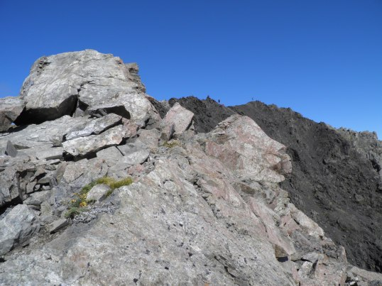 Hikers in the distance on the narrow ridge of Avalanche Peak