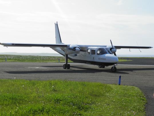 Loganair inter-island plane at Papay airfield