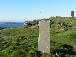 Standing stone near Kirchener Memorial; Brough of Birsay in background