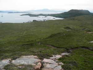 Tanera Mor from the viewpoint with Scottish mainland on horizon