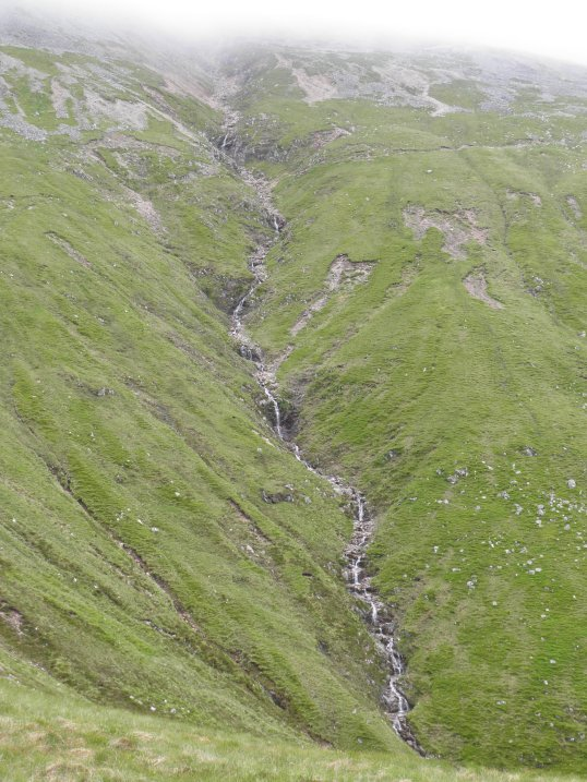 Red burn cascades from the clouds