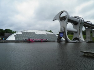Canal boat outside the visitor centre at the Falkirk Wheel