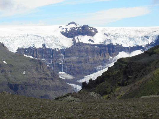 Morsárjökull glacier peaking behind the nearby ridge