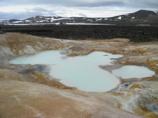 Lava field behind a mineral lake